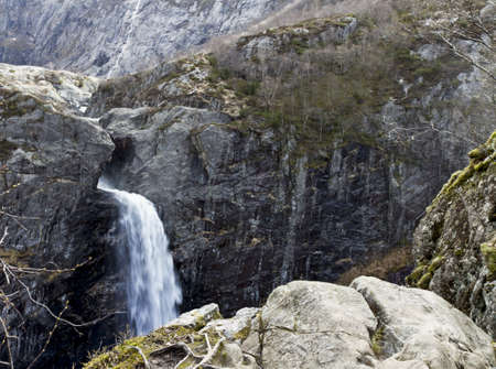steep mountain with waterfall in norway, europe photo