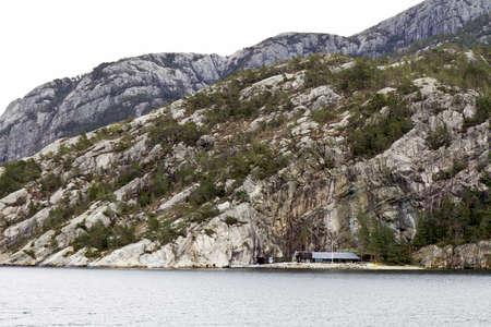 steep rock at coast in norway - horizontal image Stock Photo - 15779006