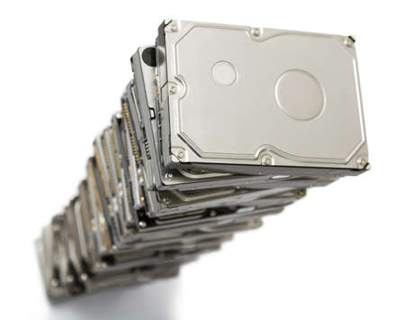 fixed disk: high stack of used hard drives in light background