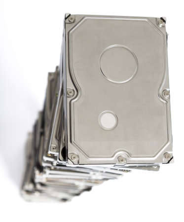 bulk memory: high stack of used hard drives in light background
