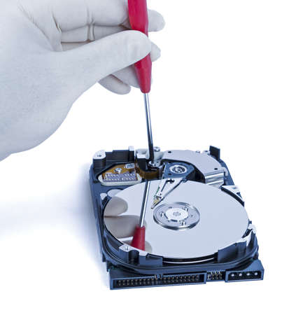 technician with open hard-disk and screwdriver in light background Stock Photo - 16063835