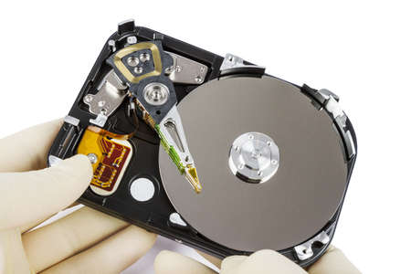 bulk memory: technician with open hard-disk in light background
