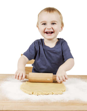 Kind die Cookies auf kleinen hölzernen Schreibtisch Lizenzfreie Bilder