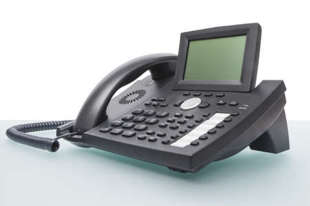 modern new telephone on desk with blank display Stock Photo - 17312437