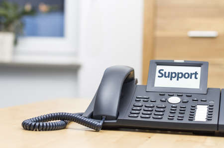 modern voip phone with the word -support- on display  Blurred background Stock Photo - 17457337