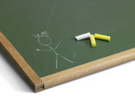 allegory painting: edge of a old used blackboard on the ground with crayon