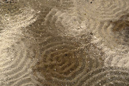 wavily: full frame abstract pattern with circles in multicolored sand