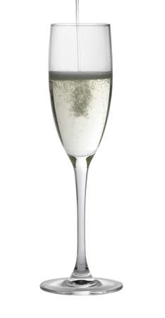 Studio photography of a champagne glass gets filled, isolated on white with clipping path