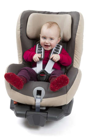 car seat: booster seat for a car in light background  studio shot with kid Stock Photo