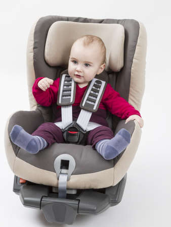 booster seat with child for a car in light background  studio shot