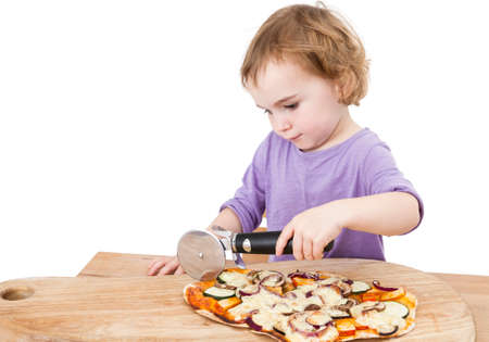 pizza cutter: girl using pizza cutter   one person in studio shot isolated on white background