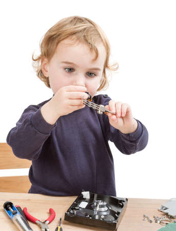 collet: little girl repairing computer parts  studio shot isolated on white background