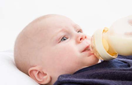 nursling: nursling with milk bottle in light background  studio shot