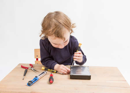 collet: young child opening hard drive with screwdriver