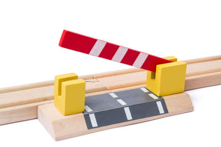 bibelot: barrier is opening to give way over wooden railroad track Stock Photo