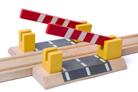 gewgaw: barrier is opening to give way over wooden railroad track Stock Photo