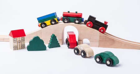 gewgaw: toy traffic with car and train isolated on grey horizontal image