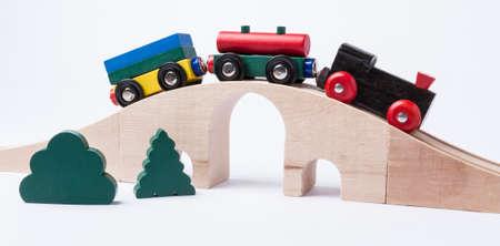 gewgaw: wooden toy train on bridge in grey horizontal image Stock Photo