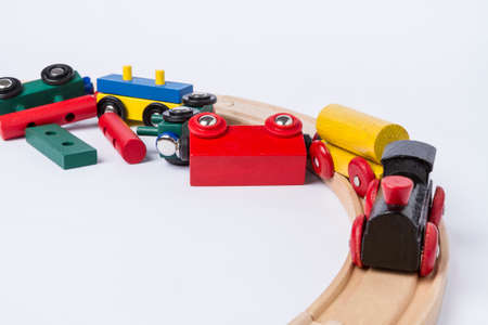 derail wooden toy train in top view  horizontal image