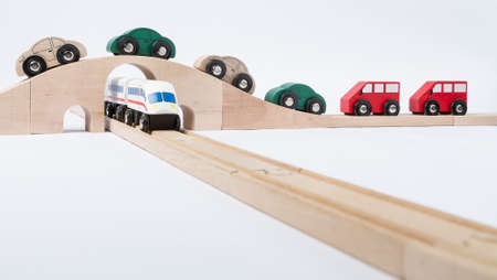 gewgaw: toy traffic with car and train isolated on grey background  horizontal image