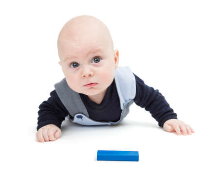 interested: interested baby with toy block on floor isolated on white