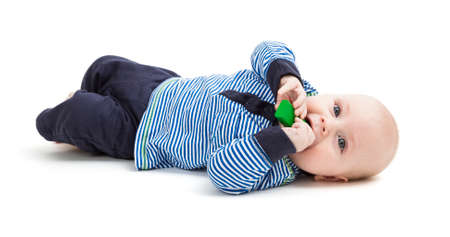 gewgaw: vertical image of toddler lying on floor  isolated on white background