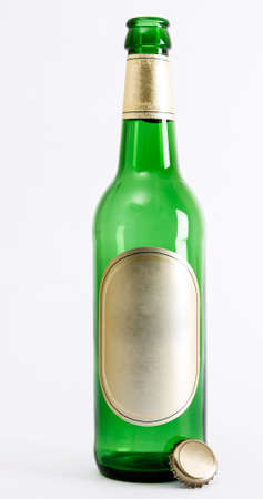 reflectance: empty green beer bottle with crown seal in light background