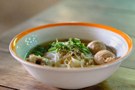Noodle and soup in bowl put on the tabl
