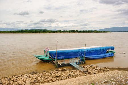 Long tail boat moored at the MEKHONG River