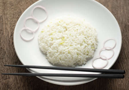 Cilantro lime in white dish,chopstick on plate 版權商用圖片
