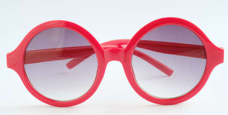 Red glasses on white background ,Close up object
