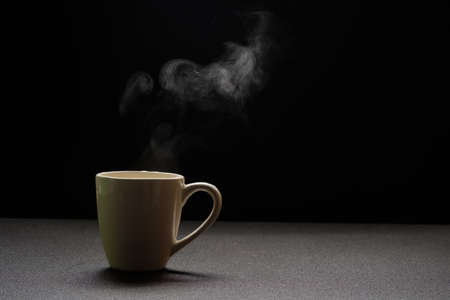 Water hot on wooden table,drink steam and copy space ,selective focus. Beverage warm concept Stockfoto