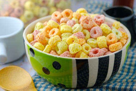 Cereal flakes in bowl Breakfast concept.Food with delicious fruity taste and fruity colours.Its made with maize,wheat,and barley