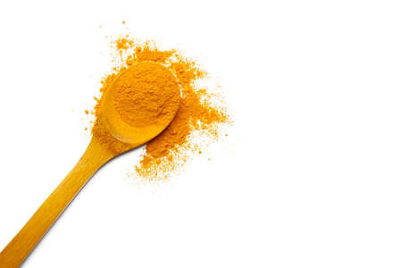 Dry turmeric powder and wooden spoon on  isolated white background.Close-up of powder orange color turmeric.top view and copy space