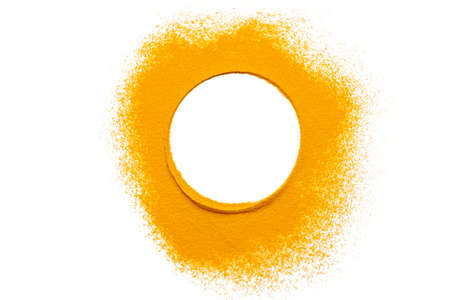 Dry turmeric powder isolated on white background.Close-up of powder orange color turmeric.top view.Circle curry Stockfoto