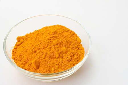Dry turmeric powder isolated on white background.Close-up of powder orange color turmeric. Stockfoto