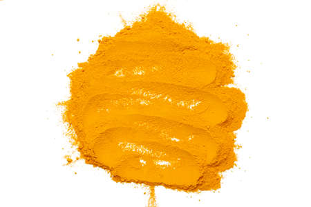 Dry turmeric powder isolated on white background.Close-up of powder orange color turmeric.top view Stockfoto