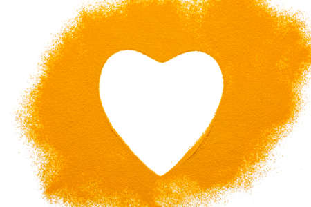 Heart turmeric powder isolated on white background.Close-up of powder orange color turmeric.top view Stockfoto