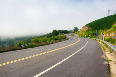 Paved road curve on mountains.Road dividing line.The road to the mountain.