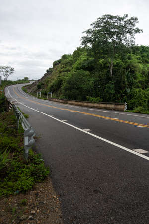 Paved road curve on mountains.Road dividing line.The road to the mountain