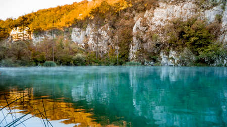 Misty Lake at dawn within the colorful Plitvice National Park in Croatia