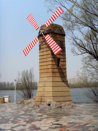 molino de agua: Windmill in a park
