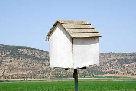 Bird house white on a background of brown mountains Stock Photo - 8611205