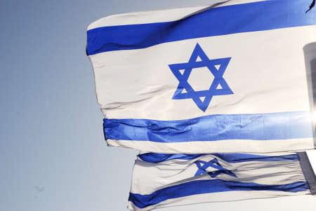 Israeli flag against the blue sky in the sun Stock Photo - 8611198