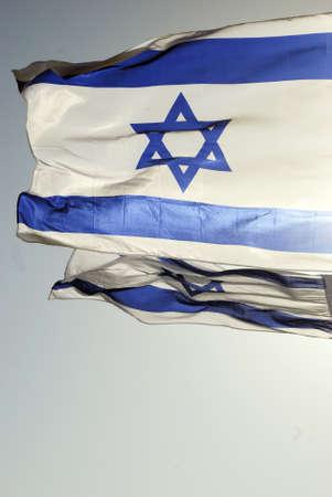 Israeli flag against the blue sky in the sun Stock Photo - 8611193
