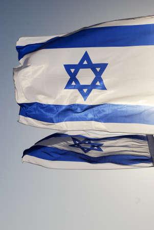 Israeli flag against the blue sky in the sun Stock Photo - 8611192