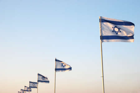 Israeli flag against the blue sky in the sun Stock Photo - 8611197