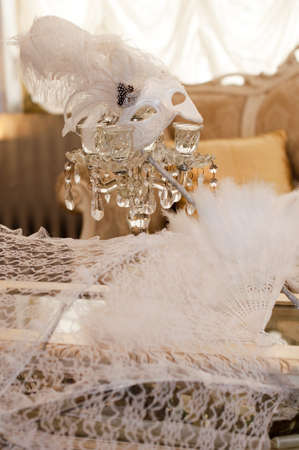 Wedding mask with a white fan and umbrella photo