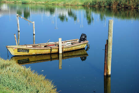 skiff: The old boat with a motor on the river