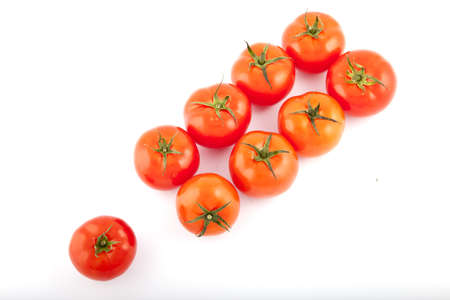 red tomatoes on white background photo